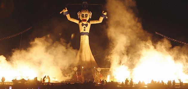 Huge Zozobra effigy burning at night