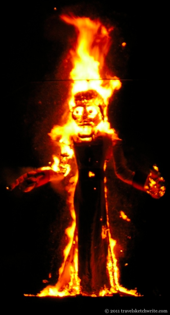 Night-time image of Zozobra burning in flames