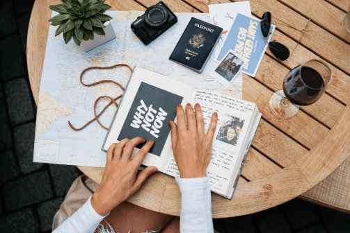 A table full of items you need to plan a trip