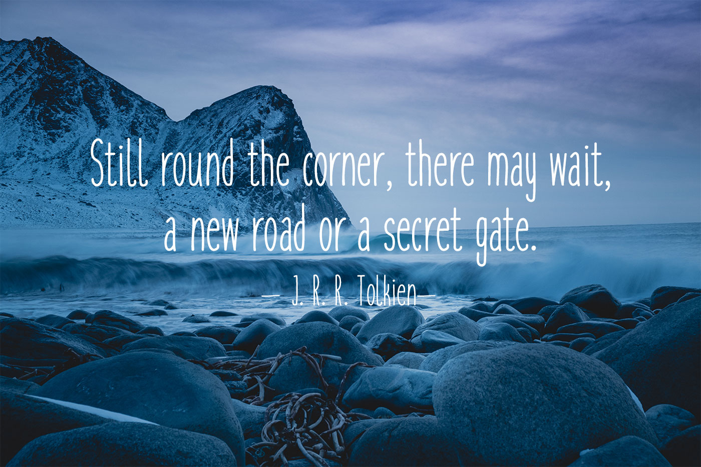 round the corner a new road quote - rocky beach with mountain background