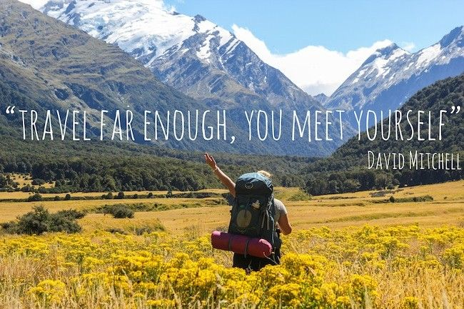 travel far enough you meet yourself quote - hiker in golden fields and snow topped mountains