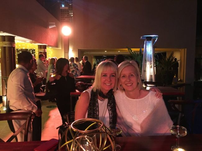 Two blonde ladies at an evening event