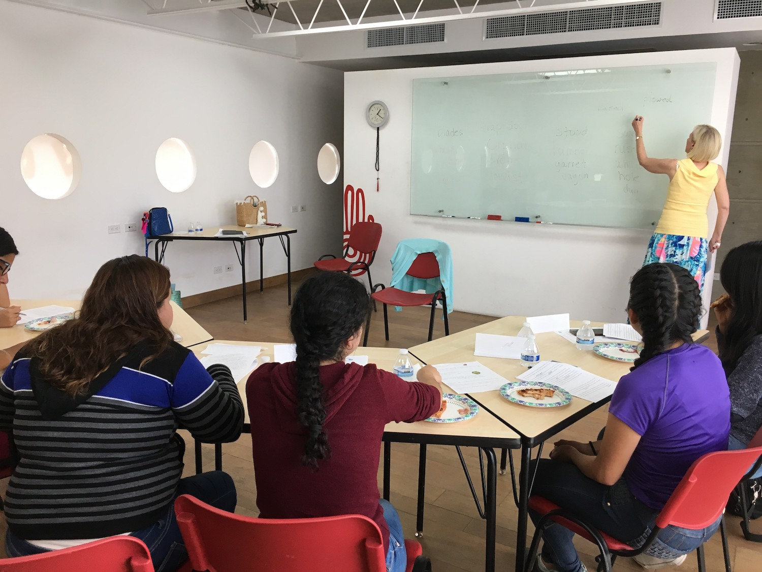 lady teaching by a white board