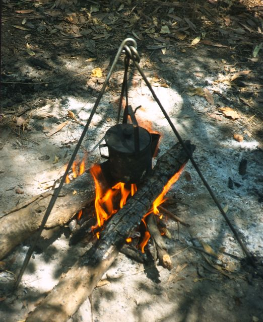 A billy can for tea over a fire in Kakadu National Park, Australia