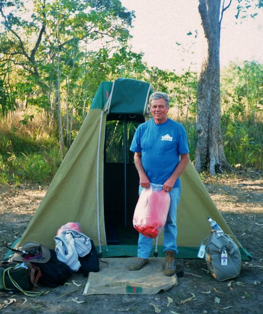 Man standing in front of a small tent in Kakadu National Park, Australia