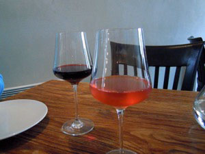 Glasses of red and rosé wine on a table