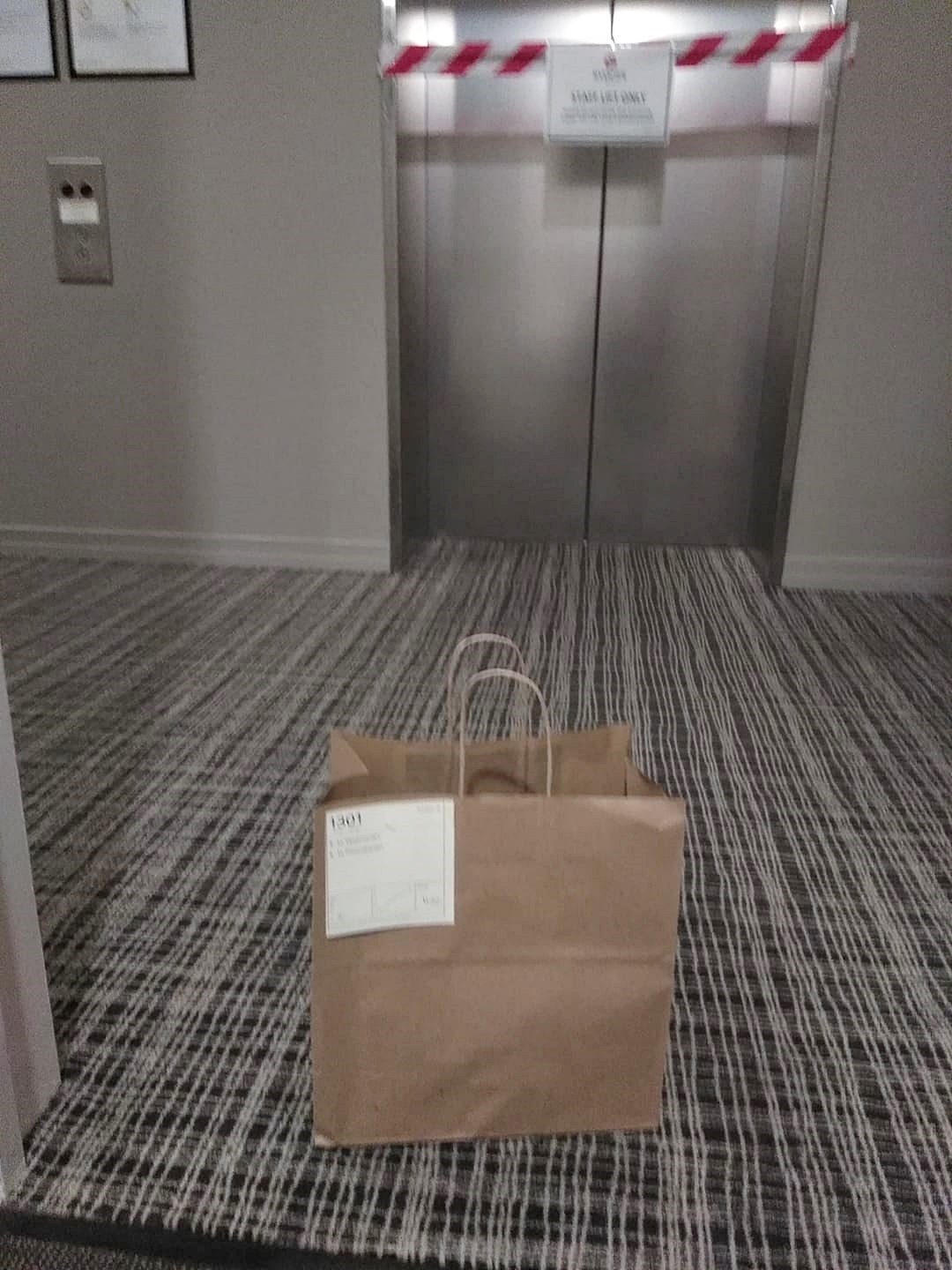 paper bag by a lift