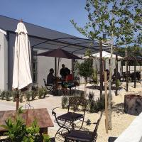Sunny outdoor seating area at Coney Wines