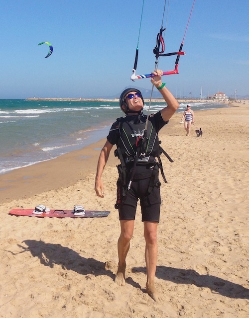 Man on beach preparing for kite surfing