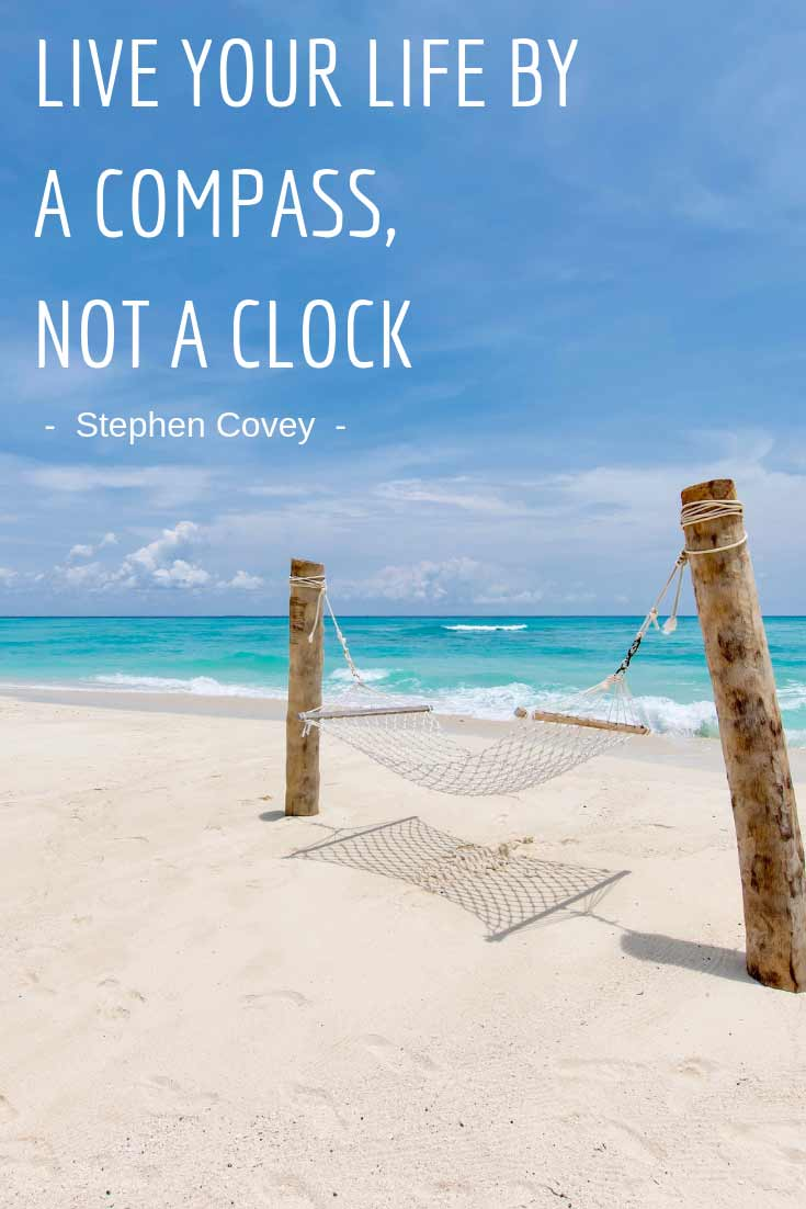 live life by a compass not a clock quote - hammock on the beach