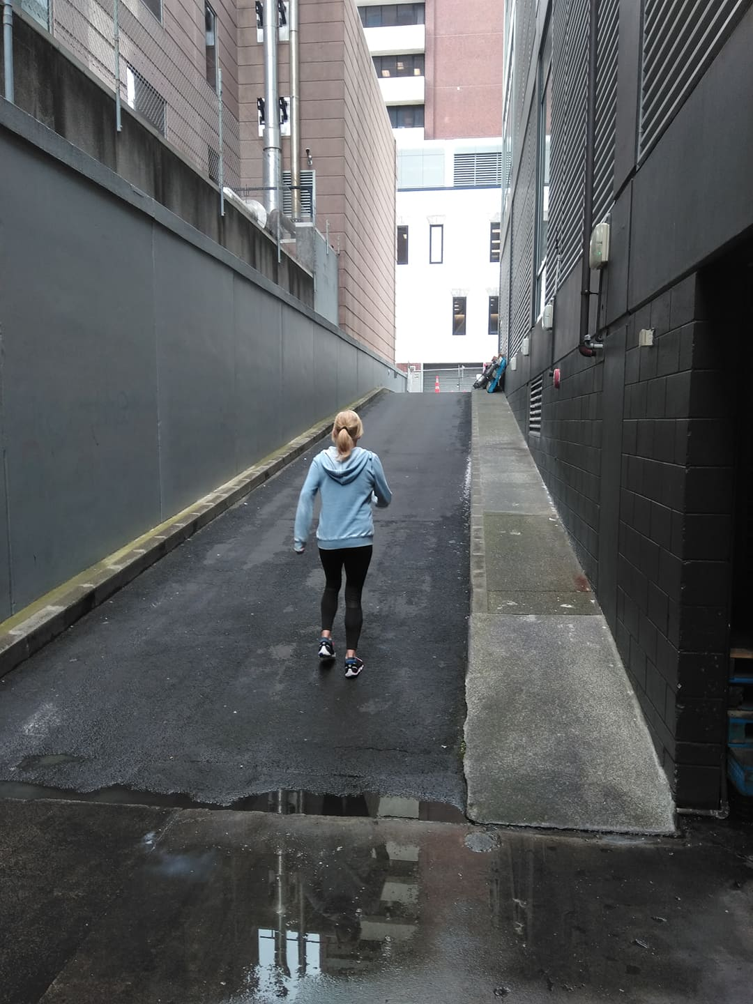 lady in blue top walking up a ramp