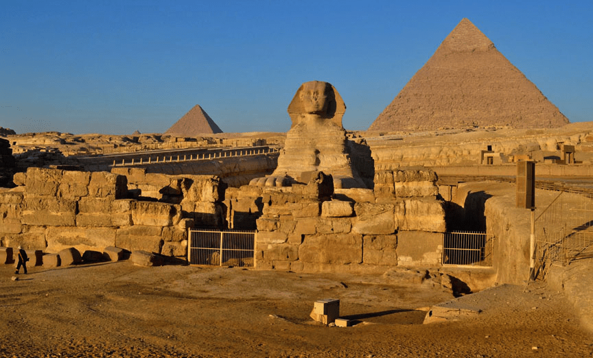 The Sphinx with the Pyramids behind
