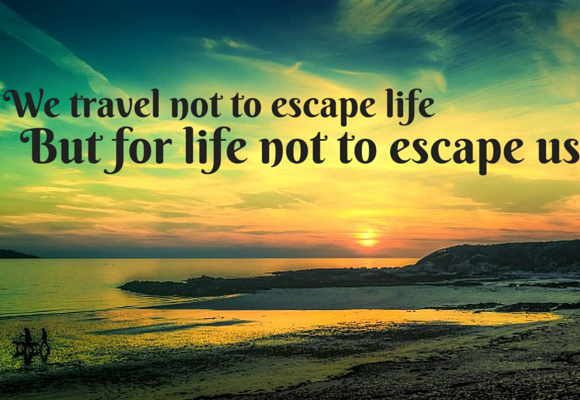 travel not to escape life quote - sunset coastal scene