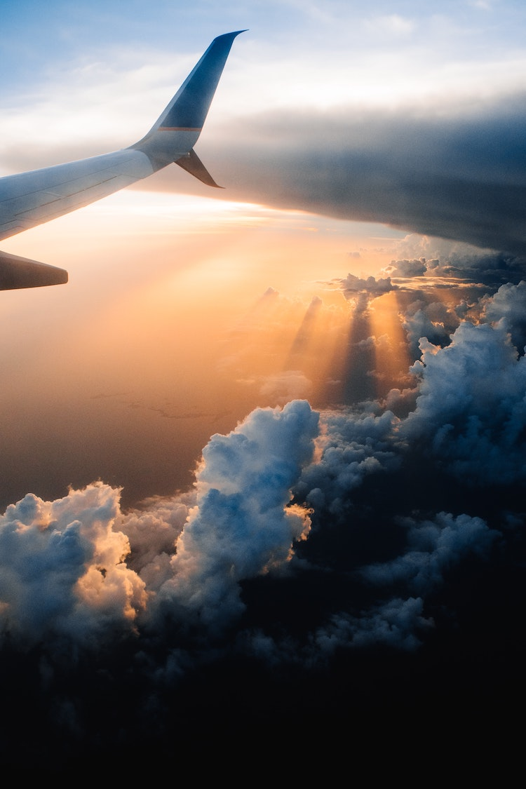 View of a plane wing at sunset