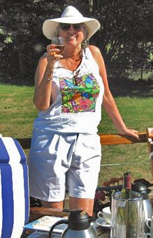 Woman on a canal boat holding a glass of wine