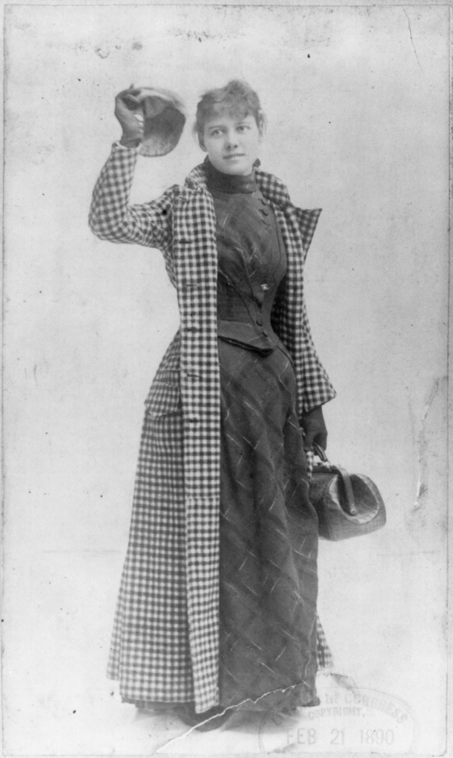 Nellie Bly in her legendary travel attire with her dress visible