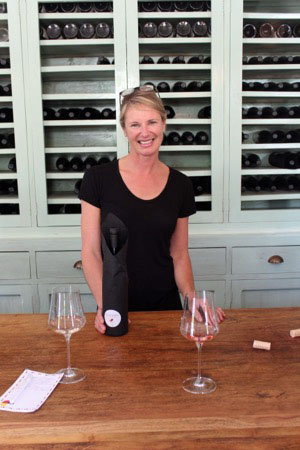 Woman serving at a wine tasting in New Zealand