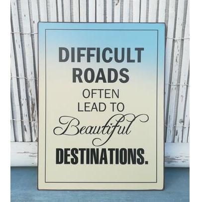 difficult roads lead to beautiful destinations quote - leaning against a wooden fence