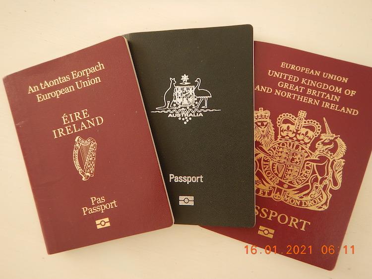Three passports, from the U.K., Republic of Ireland, and Australia