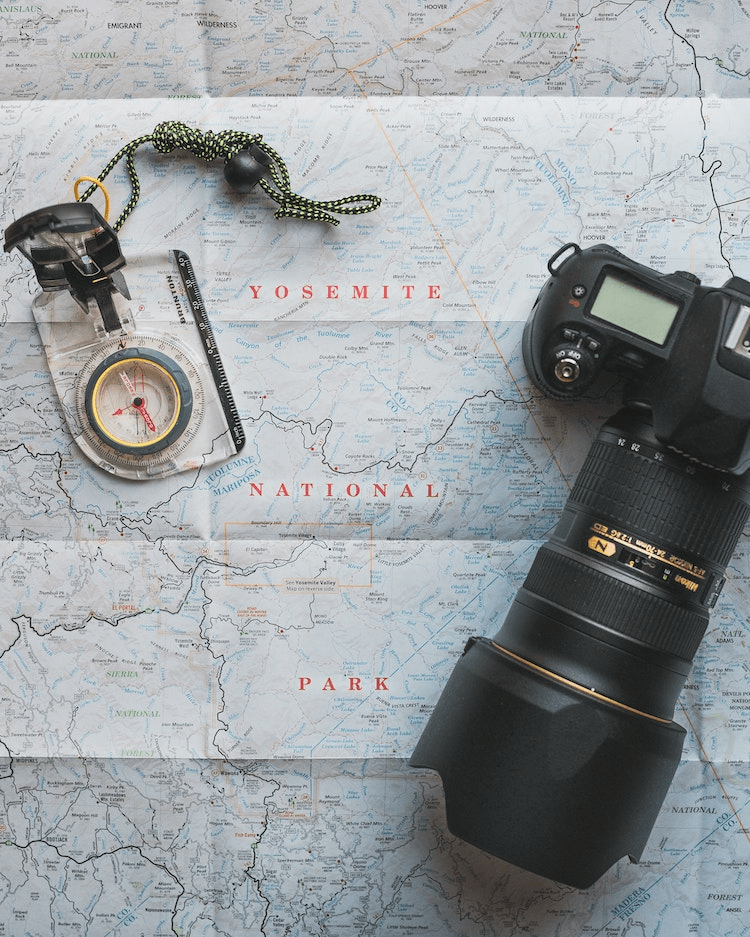 Camera compass and map to plan an adventure