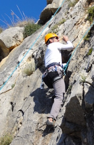 Man rock climbing on a sunny day