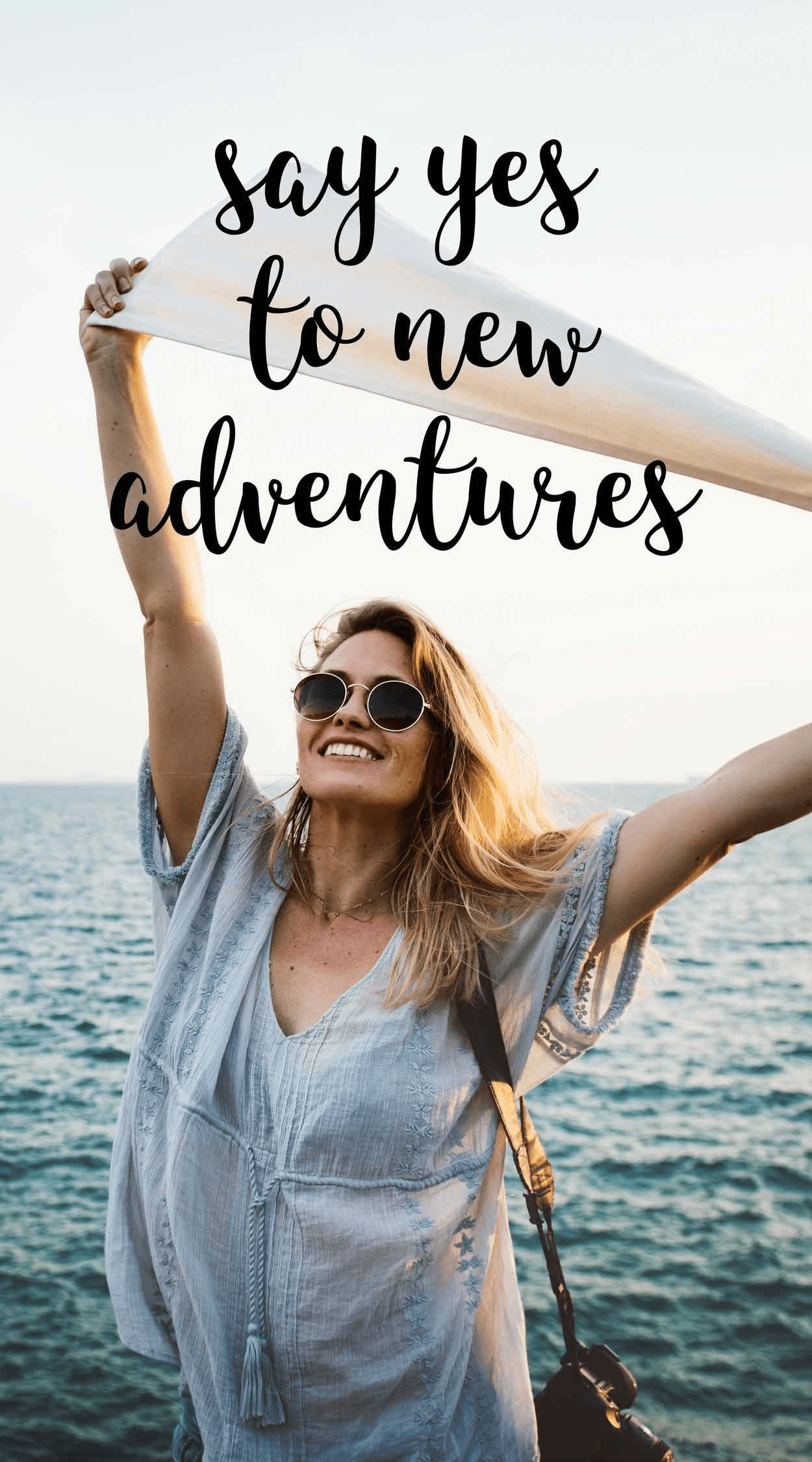 A woman raising her arms to a new adventure